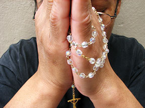 praying-rosary-file0001508606271